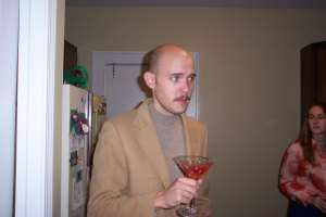 Evan with a mustache . . . and a beverage which tasted like dirt