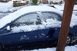 My car covered in icy snow . . . damn, I don't have a scraper