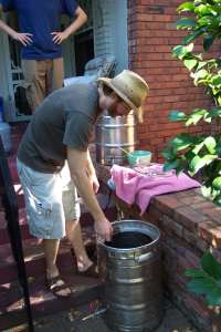 Brian transferring the wort to the boiling bin