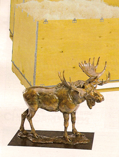 The Bronzed Moose statue in front of a wooden box informs you that you should settle for only the highest quality shipping container when you send your Uncle Vern wonderful metalic wildlife replicas